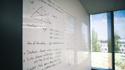 a white board with mathematical calculations written on it